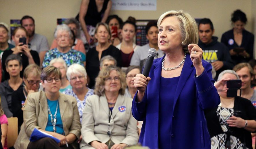 Democratic presidential candidate Hillary Rodham Clinton speaks to local residents during a campaign stop at the Iowa City Public Library in Iowa City, Iowa, on July 7, 2015. (Associated Press) **FILE**
