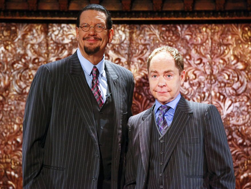 """FILE - In this June 26, 2015 file photo, Penn Jillette, left, and Teller appear at the """"Penn & Teller On Broadway"""" preview performance in New York. The duo are performing for a 6-weeks-only engagement through Aug. 16. (Photo by Andy Kropa/Invision/AP, File)"""