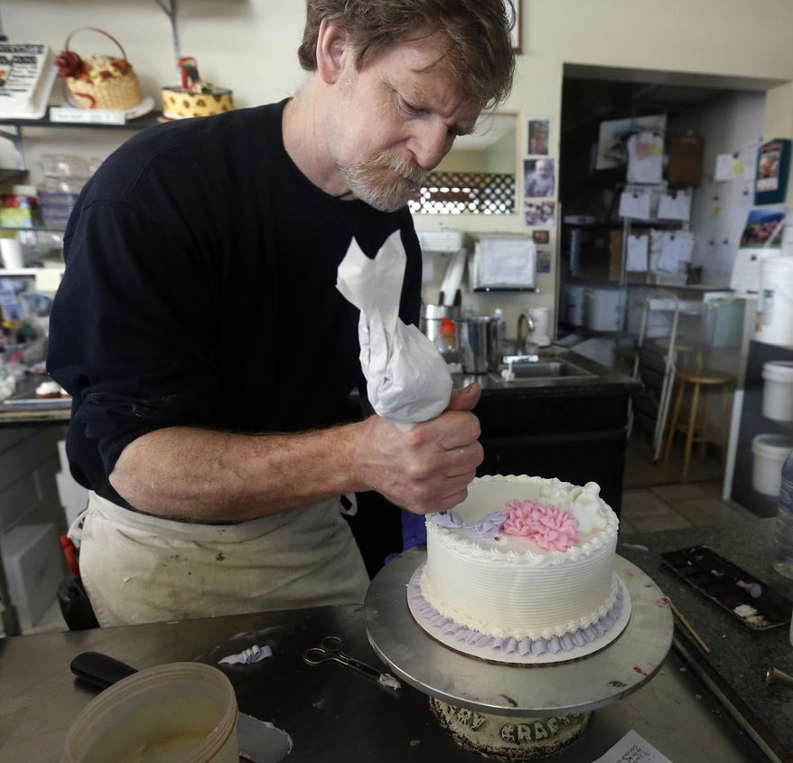 Masterpiece Cakeshop owner Jack Phillips decorates a cake inside his store in Lakewood, Colo., on March 10, 2014. Phillips, who refused to make a wedding cake for a gay couple, argued that his religious beliefs should protect him from sanctions against his business. (Associated Press) **FILE**