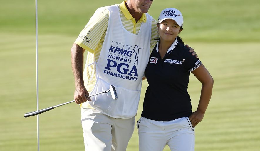 FILE - In this June 13, 2015, file photo, Sei Young Kim of South Korea hugs her caddie, Paul Fusco,  on the eighteenth hole after completing the third round of the KPMG Women's PGA golf championship at the Westchester Country Club in Harrison, N.Y. The USGA says the caddie for Sei Young Kim was removed from the U.S. Women's Open for taking photos of internal notes on the course setup. Paul Fusco will not be allowed to caddie this week at Lancaster Country Club. The Women's Open starts Thursday, July 9, 2015. (AP Photo/Kathy Kmonicek, File)