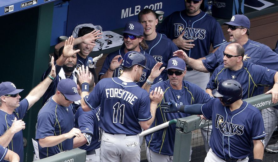 Tampa Bay Rays' Logan Forsythe (11) celebrates after scoring on a sacrifice fly by Jake Elmore during the fourth inning of the first game in a baseball doubleheader against the Kansas City Royals, Tuesday, July 7, 2015, in Kansas City, Mo. (AP Photo/Charlie Riedel)