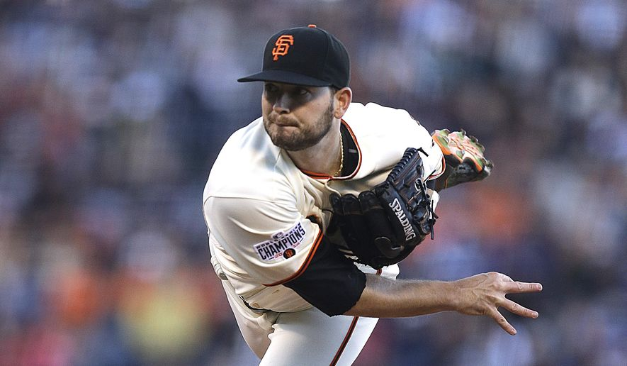 San Francisco Giants' Chris Heston works against the New York Mets in the first inning of a baseball game Monday, July 6, 2015, in San Francisco. (AP Photo/Ben Margot)