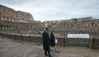 President Obama tours the Roman Empire's Colosseum with Barbara Nazzaro in 2014. (AP Photo/Pablo Martinez Monsivais/file)