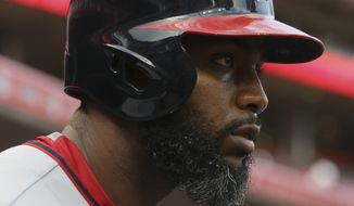 Washington Nationals center fielder Denard Span stands in the dugout in the first inning of a baseball game against the Cincinnati Reds, Friday, May 29, 2015, in Cincinnati. The Reds won 5-2. (AP Photo/John Minchillo)