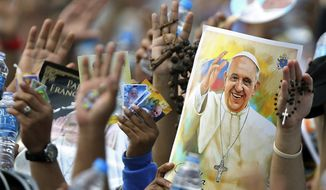 Pilgrims hold up their hands to be blessed by Pope Francis during a Mass at the Samanes Park in Guayaquil, Ecuador, Monday, July 6, 2015. Latin America's first pope arrived in this port city on Monday for the first big event of a three-nation tour that includes Paraguay and Bolivia. (AP Photo/Fernando Vergara)