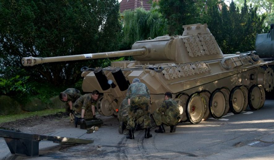 A World War II-era Panther tank is taken from an elderly man's home in Heikendorf, Germany, on July 2, 2015. (Associated Press)