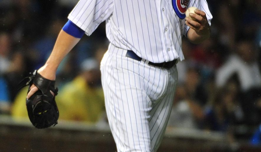 Chicago Cubs starting pitcher Jon Lester (34) reacts after giving up a run against the St. Louis Cardinals during the seventh inning of a baseball game, Monday, July  6, 2015, in Chicago. (AP Photo/David Banks)