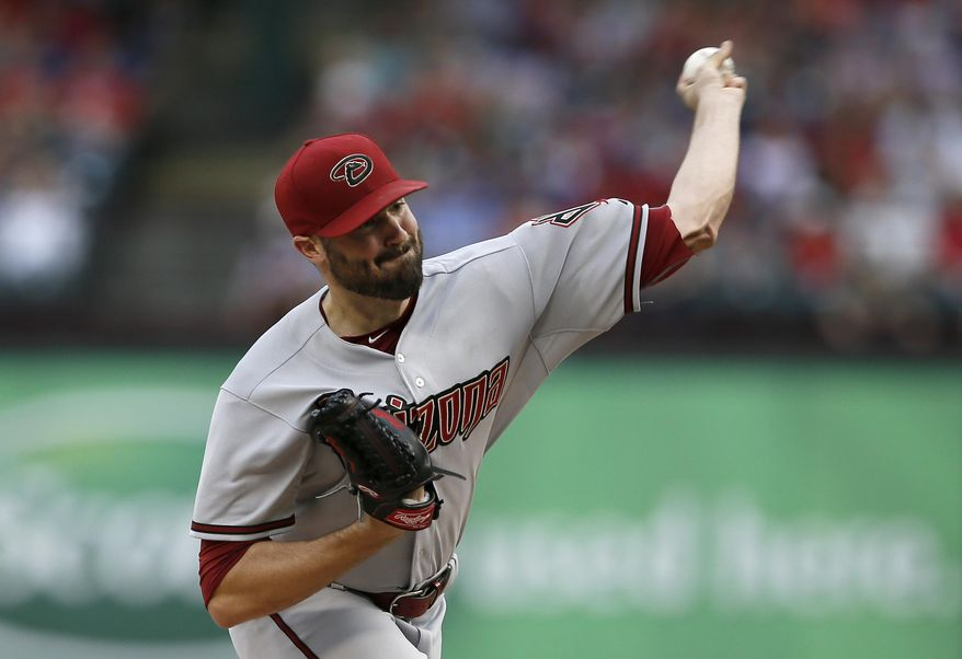 Arizona Diamondbacks starting pitcher Robbie Ray works against the Texas Rangers during the first inning of a baseball game Tuesday, July 7, 2015, in Arlington, Texas. (AP Photo/Tony Gutierrez)