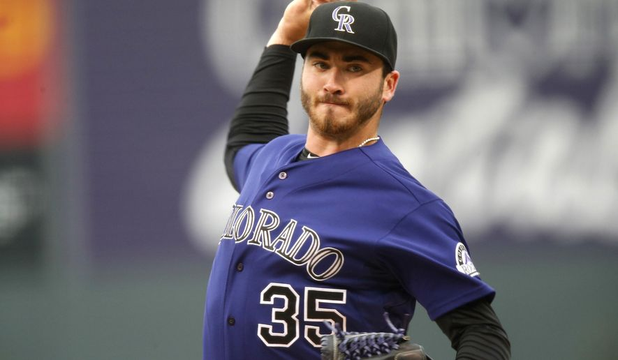 Colorado Rockies starting pitcher Chad Bettis works against the Los Angeles Angels in the first inning of an inter league baseball game Tuesday, July 7, 2015, in Denver. (AP Photo/David Zalubowski)