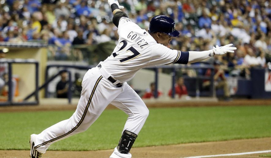 Milwaukee Brewers' Carlos Gomez hits an RBI single during the sixth inning of a baseball game against the Atlanta Braves Monday, July 6, 2015, in Milwaukee. (AP Photo/Morry Gash)