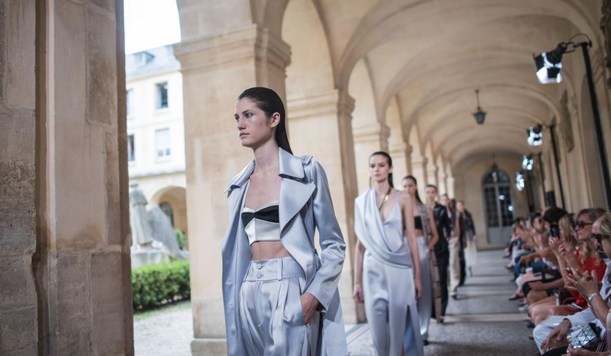 Models wear creations for Bouchra Jarrar's fall-winter 2015/2016 Haute Couture fashion collection presented in Paris, France, Tuesday, July 7, 2015. (AP Photo/Kamil Zihnioglu)