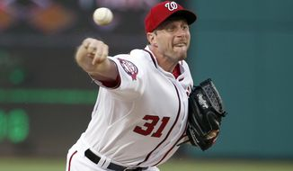 Washington Nationals starting pitcher Max Scherzer throws during the third inning of a baseball game against the Cincinnati Reds at Nationals Park, Tuesday, July 7, 2015, in Washington. (AP Photo/Alex Brandon)