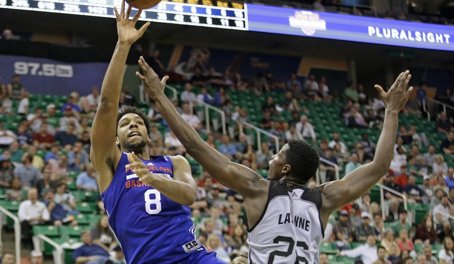 San Antonio Spurs Cady Lalanne (26)  defends against Philadelphia 76ers Jahlil Okafor (8) as he shoots during the second half of an NBA summer league basketball game Monday, July 6, 2015, in Salt Lake City.  (AP Photo/Rick Bowmer)
