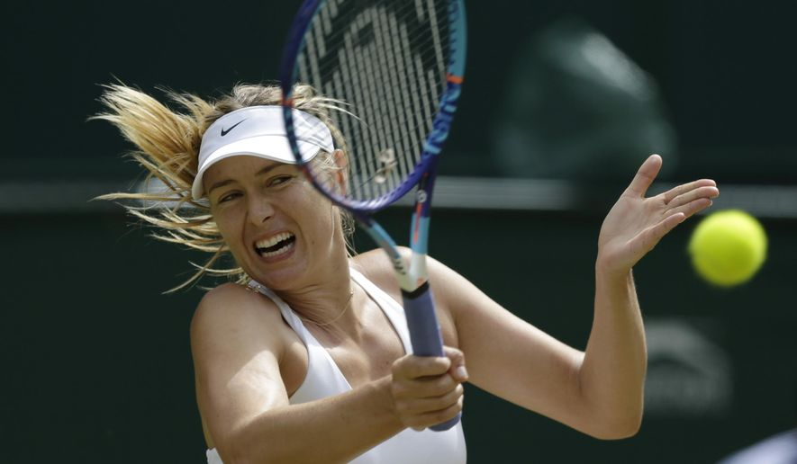 Maria Sharapova of Russia returns a ball to Coco Vandeweghe of the United States  during their singles match at the All England Lawn Tennis Championships in Wimbledon, London, Tuesday July 7, 2015. (AP Photo/Pavel Golovkin)