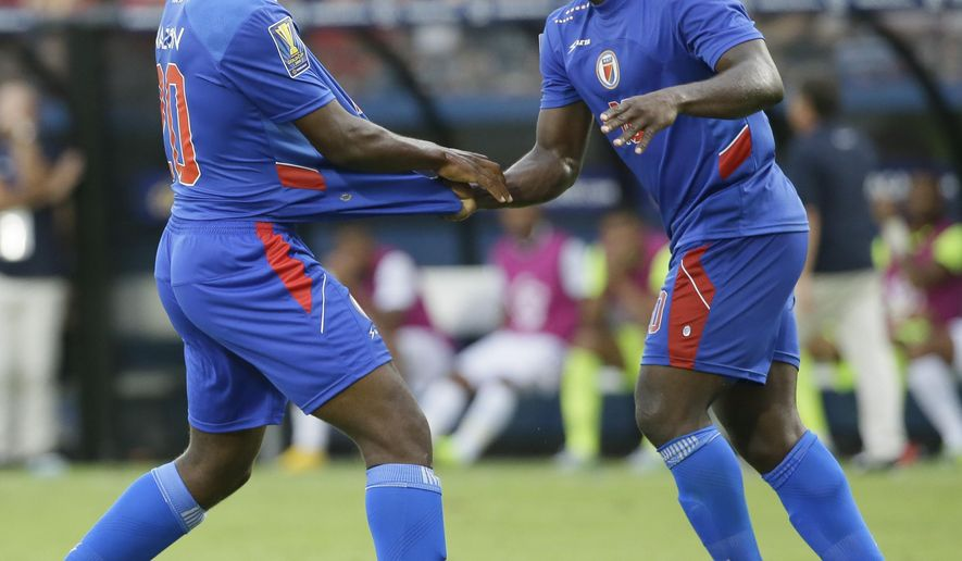 Haiti's Duckens Nazon, left, celebrates his goal with teammate Jeff Louis during the second half of a CONCACAF Gold Cup soccer game against Panama in Frisco, Texas, Tuesday, July 7, 2015. Panama and Haiti played to a 1-1 tie. (AP Photo/LM Otero)
