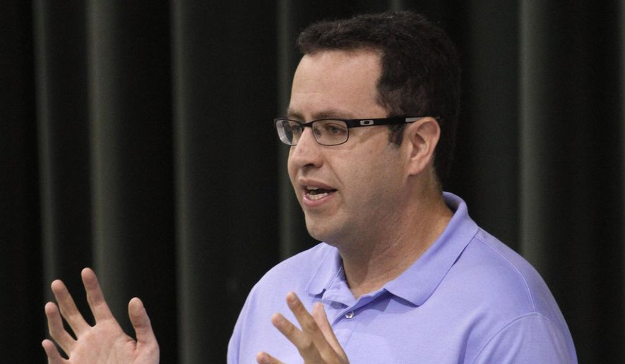In this Sept. 18, 2013, file photo, longtime Subway front man Jared Fogle speaks to students about healthy eating and exercise at Battle Academy in downtown Chattanooga, Tenn. FBI agents and Indiana State Police on Tuesday, July 7, 2015 raided Fogle's Zionsville, Ind., home and have removed electronics from the property. (Dan Henry/Chattanooga Times Free Press via AP)
