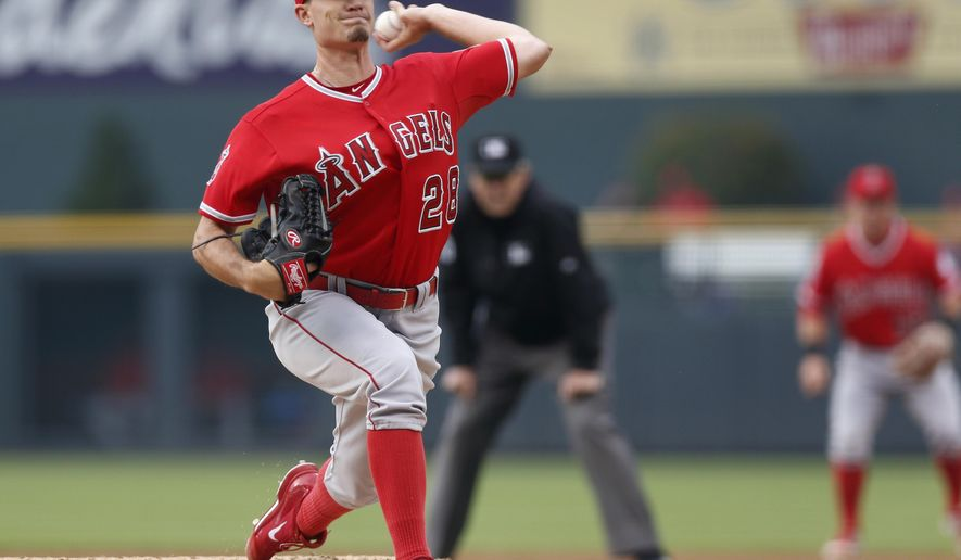 Los Angeles Angels starting pitcher Andrew Heaney works against the Colorado Rockies in the first inning of an inter league baseball game Tuesday, July 7, 2015, in Denver. (AP Photo/David Zalubowski)