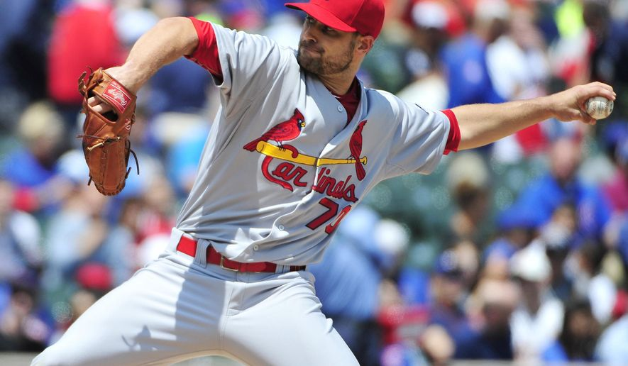 St. Louis Cardinals starting pitcher Tyler Lyons (70) throws against the Chicago Cubs during the first inning in the first baseball game of a doubleheader, Tuesday, July  7, 2015, in Chicago.  (AP Photo/David Banks)