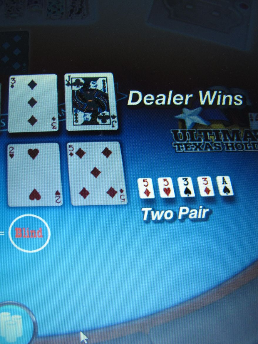 This Jan. 31, 2014 photo shows a game of Texas Hold 'Em under way on a computer screen in Atlantic City, N.J. New Jersey gambling regulators said on Tuesday, July 7, 2015 that a hacker briefly shut down four Internet gambling sites in the state last week, demanding a ransom payment in the Bitcoin online currency. No ransom was paid, and no player accounts were breached, authorities said. (AP Photo/Wayne Parry)