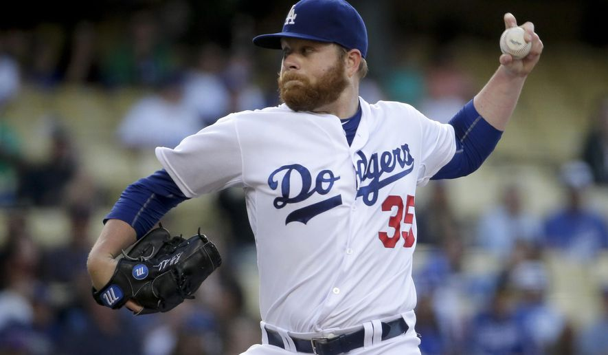 Los Angeles Dodgers starting pitcher Brett Anderson throws to the Philadelphia Phillies during the first inning of a baseball game in Los Angeles, Tuesday, July 7, 2015. (AP Photo/Chris Carlson)