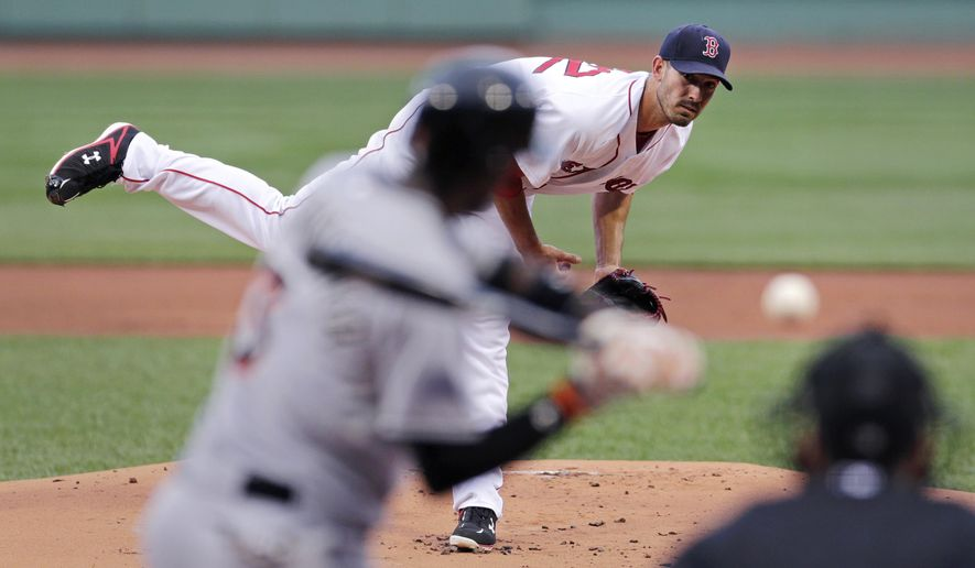 Boston Red Sox starting pitcher Rick Porcello delivers against the Miami Marlins during the first inning of a baseball game at Fenway Park in Boston, Wednesday July 8, 2015. (AP Photo/Charles Krupa)