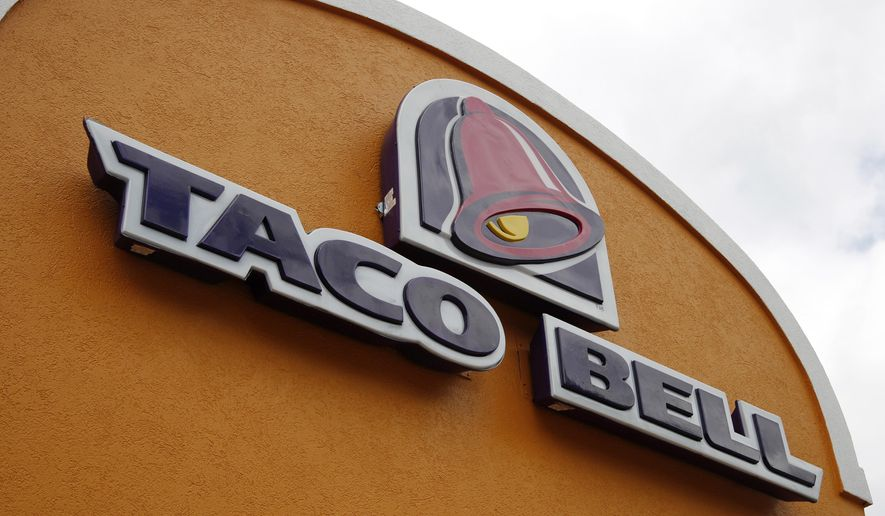 FILE - This Friday, May 23, 2014, file photo, shows the sign at a Taco Bell in Mount Lebanon, Pa. Taco Bell is starting delivery service on Wednesday, July 8, 2015, in certain markets in a partnership with the startup delivery company DoorDash. Delivery will be available initially in more than 90 cities and more than 200 restaurants around Los Angeles, San Francisco and Dallas. (AP Photo/Gene J. Puskar, File)