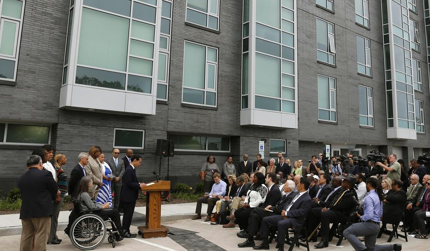 Housing and Urban Development Secretary Julian Castro announces a policy change at a news conference Wednesday, July 8, 2015, in Chicago next to new public housing units on the city's South Side. The new rules provide guidance to help cities achieve the promises of the 1968 Fair Housing Act by promoting racially integrated neighborhoods. (AP Photo/Christian K. Lee)
