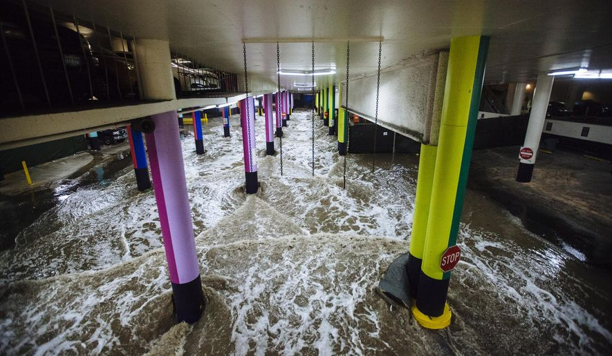 A flash flood flows through the LINQ hotel parking garage and surrounding areas Monday, July 6, 2015 in Las Vegas, Nev. Las Vegas braced for another summer downpour Tuesday, a day after a powerful thunderstorm flooded roads, forced water rescues and diverted air traffic. Monday's thunderstorm started around 6 p.m. and hit foothills in the Lone Mountain and Summerlin areas the hardest. (Mikayla Whitmore/Las Vegas Sun via AP) LAS VEGAS REVIEW-JOURNAL OUT; MANDATORY CREDIT