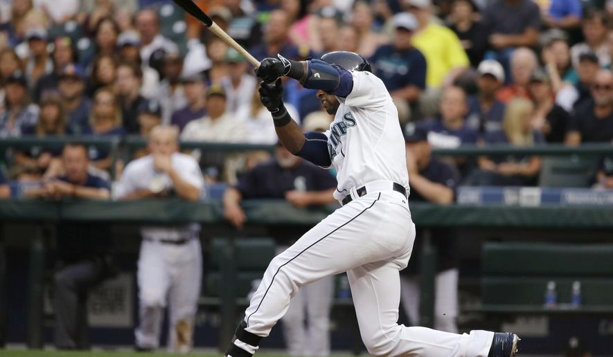 Seattle Mariners' Austin Jackson hits a grand slam during the third inning of a baseball game against the Detroit Tigers, Tuesday, July 7, 2015, in Seattle. (AP Photo/Ted S. Warren)