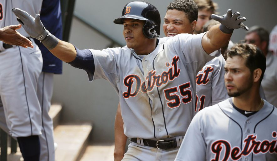 Detroit Tigers' Jefry Marte (55) celebrates in the dugout after he hit his first major-league home run in the fourth inning of a baseball game against the Seattle Mariners, Wednesday, July 8, 2015, in Seattle. (AP Photo/Ted S. Warren)