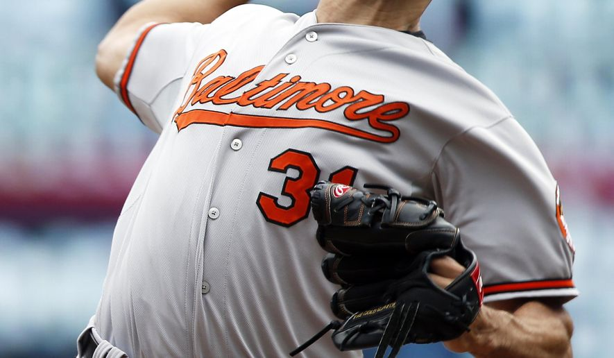 Baltimore Orioles pitcher Ubaldo Jimenez throws against the Minnesota Twins in the first inning of a baseball game, Wednesday, July 8, 2015, in Minneapolis. (AP Photo/Jim Mone)