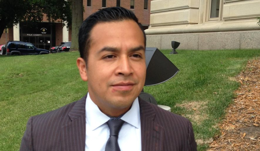 Cesar Vargas stands outside the Polk County Courthouse in Des Moines, Iowa, on Wednesday, July 8, 2015 after a hearing in which a judge denied his request to end his probation early on a simple misdemeanor trespassing charge. Vargas was charged after challenging New Jersey Gov. Chris Christie on his stand on immigration at a political rally in Des Moines in January. Vargas is seeking to become an attorney in New York but his probation in Iowa is delaying his acceptance. By David Pitt. (AP Photo/David Pitt)