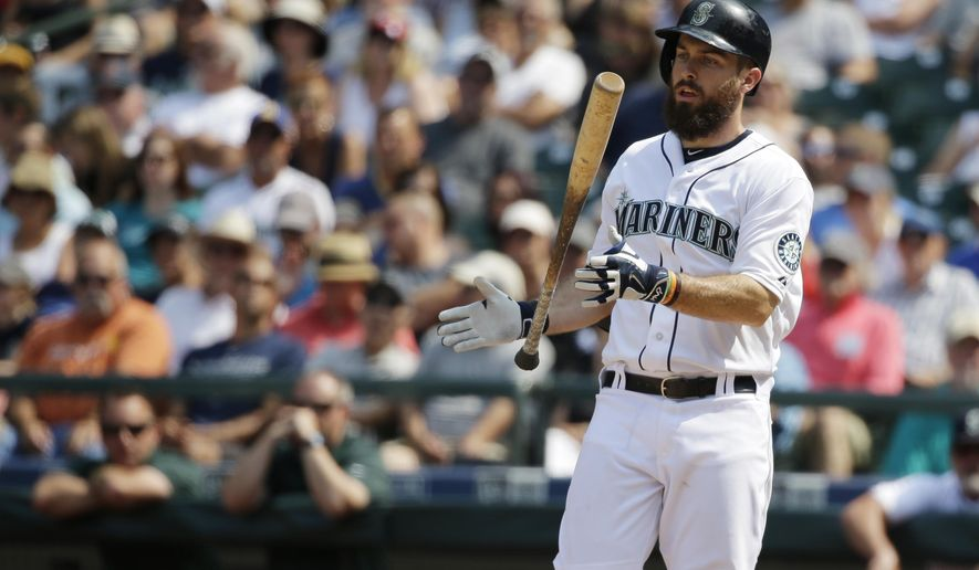 Seattle Mariners' Dustin Ackley tosses his bat after flying out in the seventh inning of a baseball game against the Detroit Tigers, Wednesday, July 8, 2015, in Seattle. The Tigers beat the Mariners 5-4. (AP Photo/Ted S. Warren)
