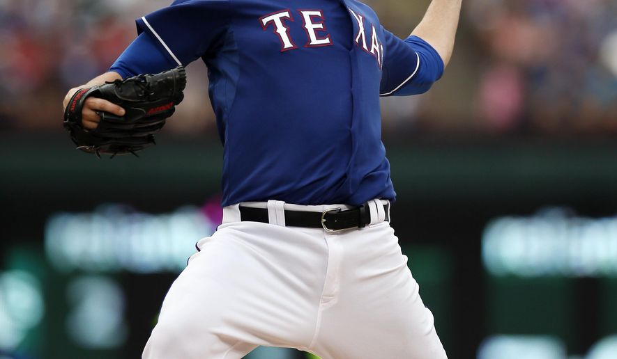 Texas Rangers starting pitcher Matt Harrison (54) works against the Arizona Diamondbacks in the first inning of an interleague baseball game Wednesday, July 8, 2015, in Arlington, Texas. (AP Photo/Tony Gutierrez)