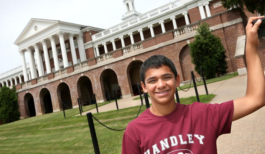 In this June 23, 2015 photo, John Handley High School sophomore Joseph Rosenfeld poses for a photo at the school in Winchester, Va. Rosenfeld discovered a decades-old math error that had gone unnoticed at the Museum of Science in Boston during a visit in June. (Jeff Taylor/The Winchester Star via AP) MANDATORY CREDIT