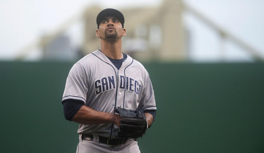 San Diego Padres starting pitcher Tyson Ross walks to the dugout after retiring the side during the first inning of a baseball game against the Pittsburgh Pirates in Pittsburgh, Tuesday, July 7, 2015. (AP Photo/Vincent Pugliese)