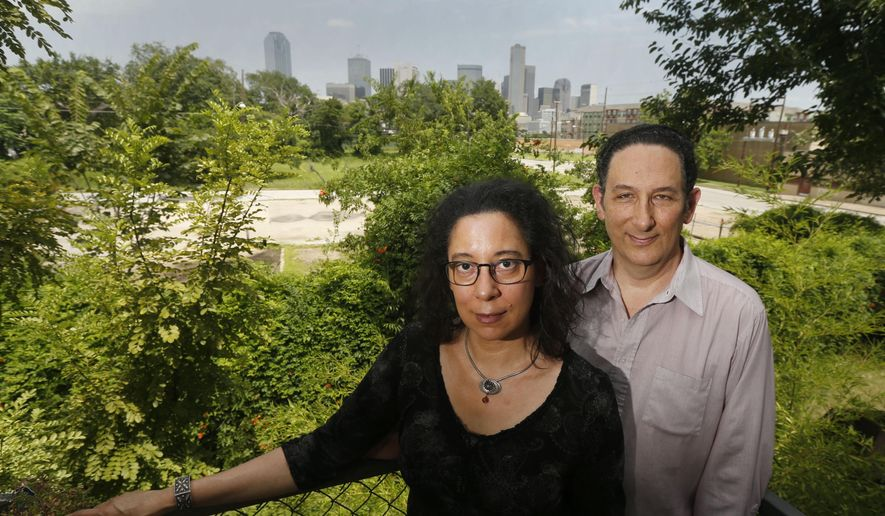 In this Saturday, July 4, 2015 photo, Angela Alston and her husband Hugh Resnick, of The Dallas Cohousing Project, pose for a photo in Dallas. The couple has revived efforts to launch a cohousing community in Dallas. (Michael Ainsworth/The Dallas Morning News via AP)
