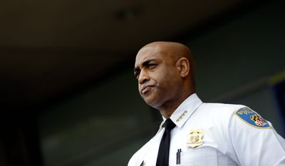 In this April 30, 2015, file photo, Baltimore Police Department Commissioner Anthony Batts listens as Deputy Commissioner Kevin Davis speaks at a news conference, in Baltimore. Baltimore Mayor Stephanie Rawlings-Blake announced the firing of Batts in a news release Wednesday, July 8. (AP Photo/Patrick Semansky, File)