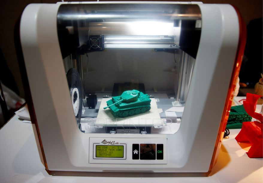 """Sales of 3-D printers are expected to double to 217,000 this year. The Defense Department is testing how they can help soldiers in the field by """"printing"""" food, medicine and weapons, and is even exploring the ideas of printing antennas and warheads. (Associated Press)"""
