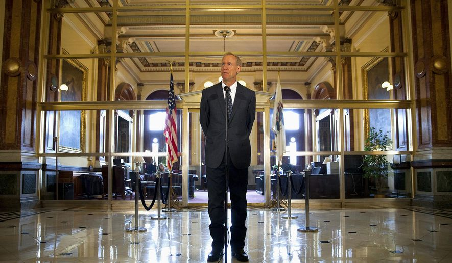 Illinois Gov. Bruce Rauner comments on the budget stalemate outside his Capitol office in Springfield, Wednesday, July 8, 2015. Rauner says he'll set aside his distaste for tax increases and approve one if the Legislature approves his business-friendly reforms. (Rich Saal/The State Journal-Register via AP) MANDATORY CREDIT, NO SALES