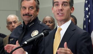 """Los Angeles Mayor Eric Garcetti, right, speaks as Police Chief Charlie Beck listens at left at a news conference to discuss mid year crime statistics in Los Angeles Wednesday, July 8, 2015. Crime has increased 13 percent in Los Angeles in the first six months of the year, ending more than a decade of declines in the nation's second-largest city, according to statistics released by the Los Angeles Police Department on Wednesday. Garcetti said """"this is bad news"""" but that Los Angeles remains one of the safest large cities in the U.S. Beck partially attributed the crime spike to increases in homelessness, gang crime and domestic violence.(AP Photo/Nick Ut)"""