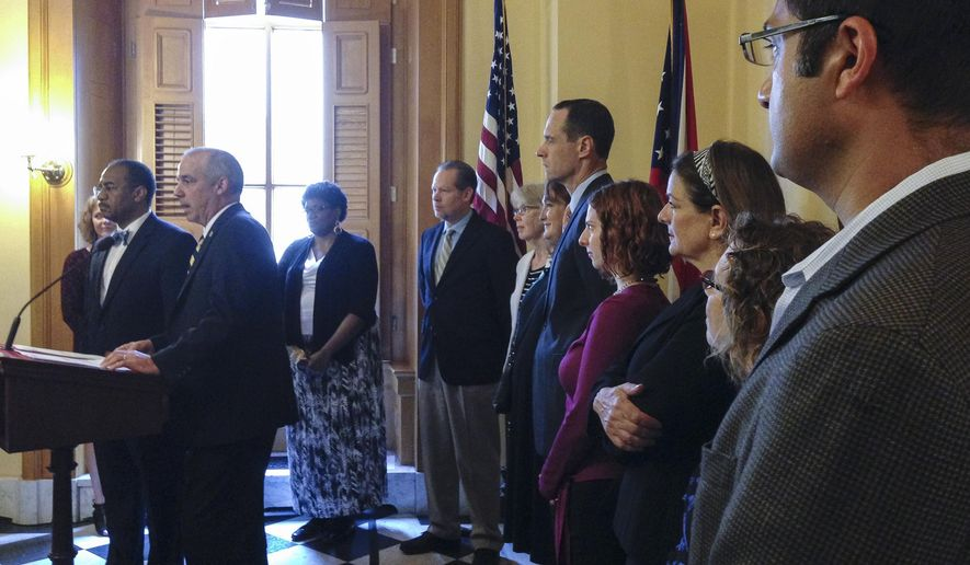 Campaign co-chairs Vernon Sykes, D-OH, left, and Matthew Huffman, R-OH, second from left, kick off a fall ballot campaign for redistricting reform at the Ohio Statehouse, Wednesday, July 8, 2015, in Columbus, Ohio. They are flanked by representatives of a host of interest groups that have endorsed the proposal. (AP Photo/Julie Carr Smyth)