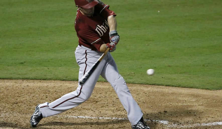 Arizona Diamondbacks' A.J. Pollock swings at a pitch from Texas Rangers' Matt Harrison that went for a single in the fifth inning of an interleague baseball game Wednesday, July 8, 2015, in Arlington, Texas. (AP Photo/Tony Gutierrez)