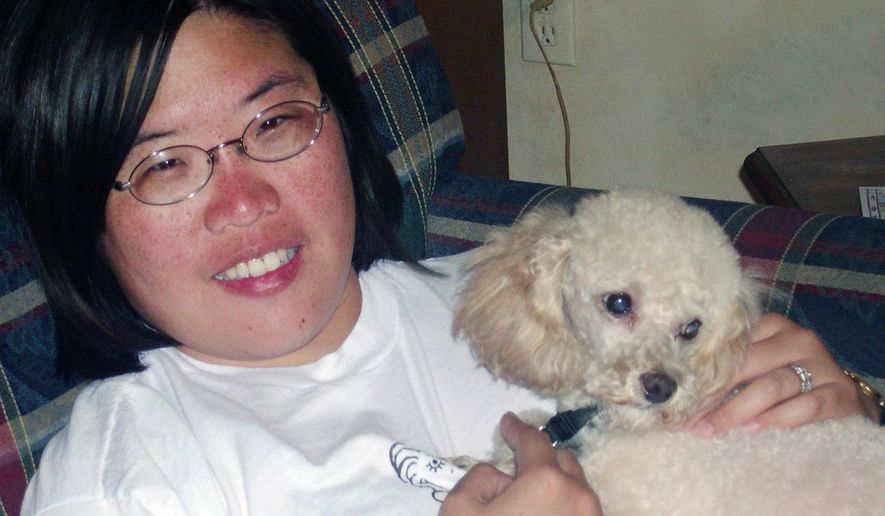 This undated photo provided by Scott Wyskocil shows Elsa Wyskocil with her dog Curly a 10-pound poodle in Palm Springs, Calif. Scott and Elsa Wyskocil of Los Angeles took their poodle for a wash and trim in January 2014 at C&C Pet Food for Less, which also operates a grooming business, but Curly didn't make it home. He died after being placed in a hot dryer, with his internal temperature higher than 109 degrees an hour after his death, documents show. (Scott Wyskocil via AP)