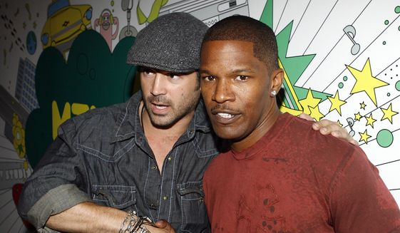 Colin Farrell and Jamie Foxx pose backstage during MTV's 'Total Request Live' at the MTV Times Square Studios Monday, July 24, 2006 in New York. Mr. Farrell and Mr. Foxx star in the new movie 'Miami Vice,' which premieres Friday and is about undercover cops fighting drug trafficking. (AP Photo/Jason DeCrow)