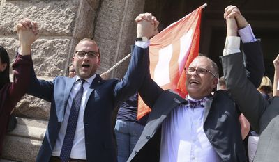 Human Rights Campaign president Chad Griffin. left, and Jim Obergefell, named plaintiff in the historic U.S. Supreme Court same-sex marriage case, cheer during a press conference held at the Texas Capitol to discuss the local effect of the marriage equality ruling on Monday, June 29, 2015 in Austin, Texas. (Jack Plunkett/AP Images for Human Rights Campaign)