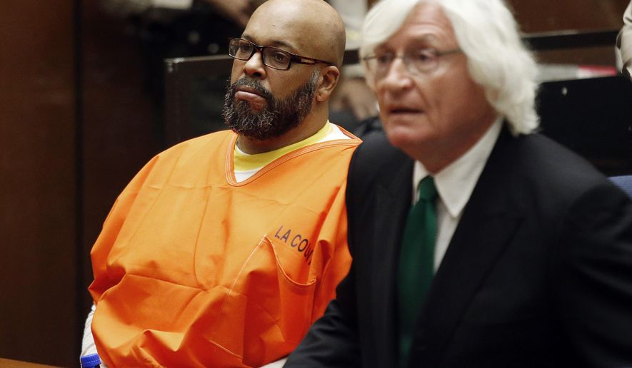 """FILE - In this Tuesday, July 7, 2015 photo, Marion Hugh """"Suge"""" Knight, left, sits with his attorney Thomas Mesereau, in Los Angeles Superior  Court, during a hearing in a murder case filed against the Death Row Records co-founder. Mesereau states in a court filing released Wednesday, July 8, 2015, that new video of a January 2015 confrontation that ended with Knight running over two men, killing one, shows there were multiple armed men and his client was fleeing an attacker who had a handgun. (Patrick T. Fallon/Pool Photo via AP, File)"""