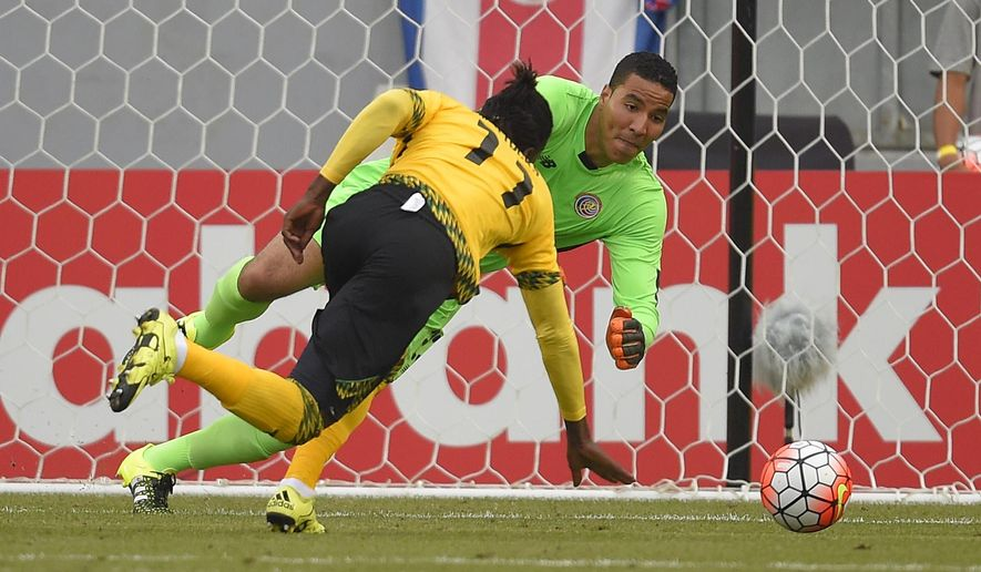 Costa Rica's Esteban Alvarado, right, makes a stop on a shot as Jamaica's Darren Mattocks runs in during the second half of CONCACAF Gold Cup soccer match, Wednesday, July 8, 2015, in Carson, Calif. The match ended in a 2-2 tie. (AP Photo/Mark J. Terrill)
