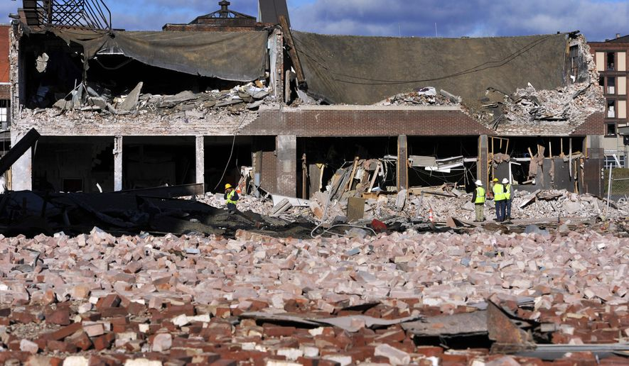 FILE - In this Nov. 24, 2012 file photo, inspectors assess damage around the area of a gas explosion that leveled a strip club in Springfield, Mass. on Nov. 23. The Obama administration moved Wednesday, July 8, 2015 to significantly expand a requirement for utilities to install inexpensive safety valves on natural gas lines across the U.S. to reduce the risk of deadly explosions. An Associated Press investigation in 2012 uncovered more than 270 accidents dating to 1968 that could have been prevented or made less dangerous if the valves had been in place, including the 2012 Springfield blast.(AP Photo/Jessica Hill, File)
