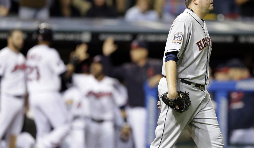 Houston Astros' relief pitcher Joe Thatcher walks back to the mound as the Indians celebrate after two runs score in the eighth inning of a baseball game, Wednesday, July 8, 2015, in Cleveland. The Indians won 4-2. (AP Photo/Tony Dejak)